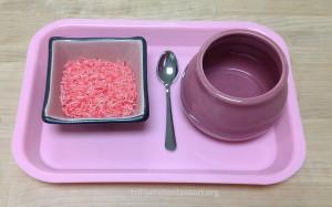 Spooning Pink Rice - Trillium Montessori Fine Motor