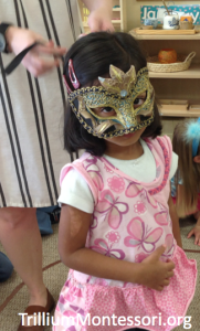 Trying on a mask from Italy
