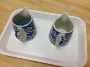 Pouring blue rice- Montessori fine motor winter