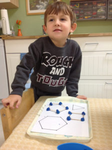Making shapes with playdoh and toothpicks