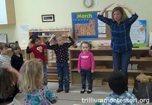 Doing a dance from Africa - Trillium Montessori