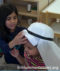 Trying on a hat from Egypt (Africa) - Trillium Montessori