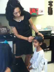 Montessori Graduation- getting fitted for a cap