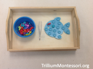 Beach theme fine motor activity tweezing beads onto fish suction mat